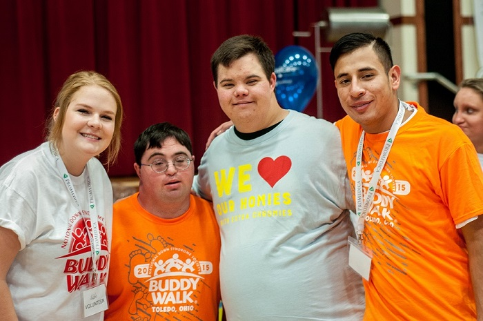 A volunteer smiles with Toledo Buddy Walk Participants